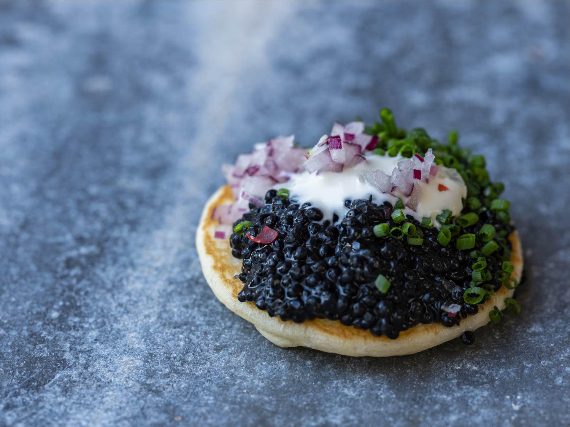 Black kelp caviar on crepe - plant based caviar